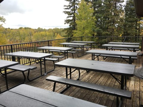 Off the dinning room is a spacious outside deck with 10 picnic tables that overlook the river below.