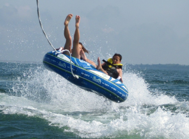 WATER SPORTS -  Dandy Auto Marine has been our sponsor for years and has set us up with state of the art boat, ski, board, surf, and tubing equipment! This activity fills up fast and lasts for half a day each day! Try your hand at riding the big wave as you wake-surf!
